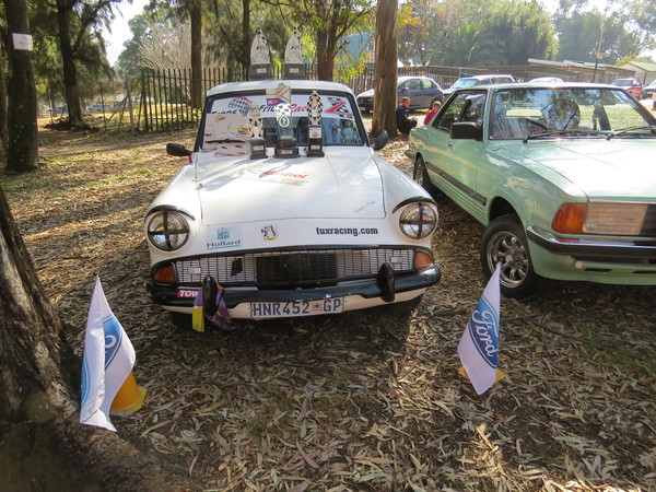 Fossa Ford Anglia with all her trophies and her sister