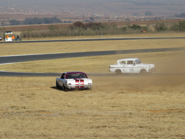 Fossa passing a Mustang during its rally stage