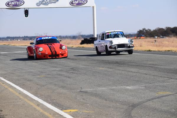 Pre66, Fossa Ford Anglia in action with the leading Porsche passing